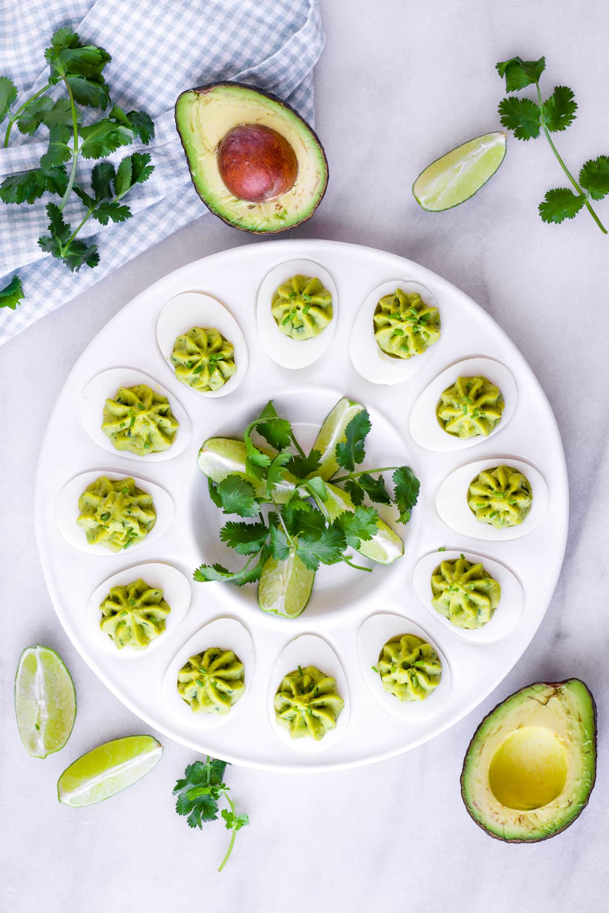 top view of arranged avocado deviled eggs on a round plate