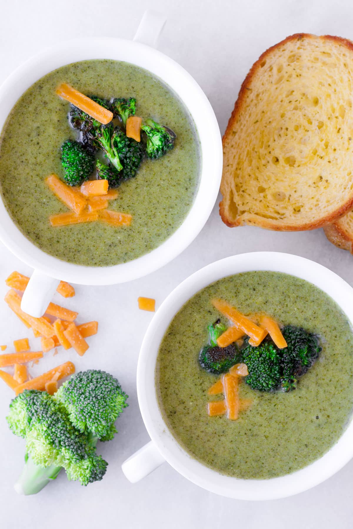top view of two bowls of creamy vegetable soup