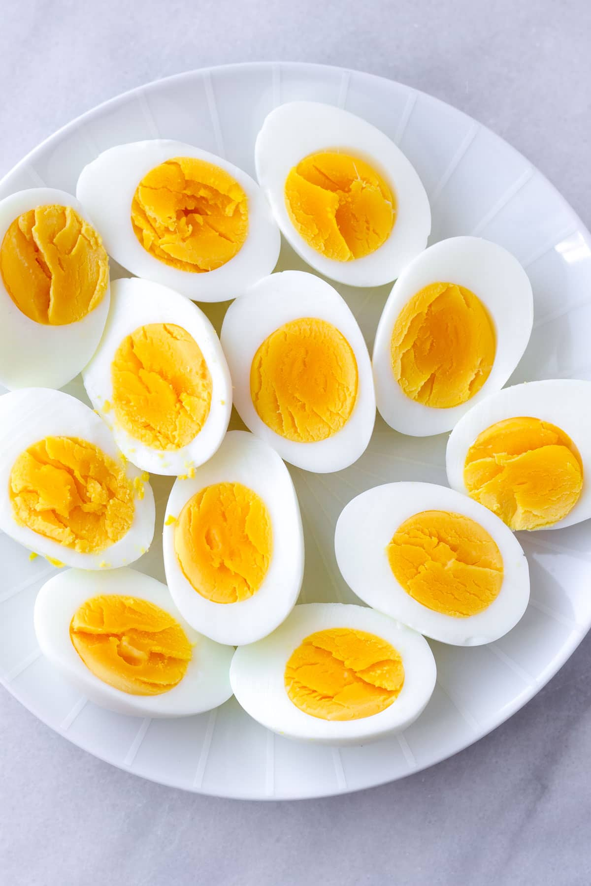 eggs cut in half showing fully cooked egg yolks