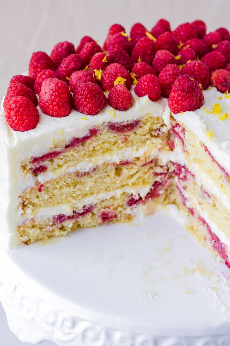close up of the cake with fresh raspberries