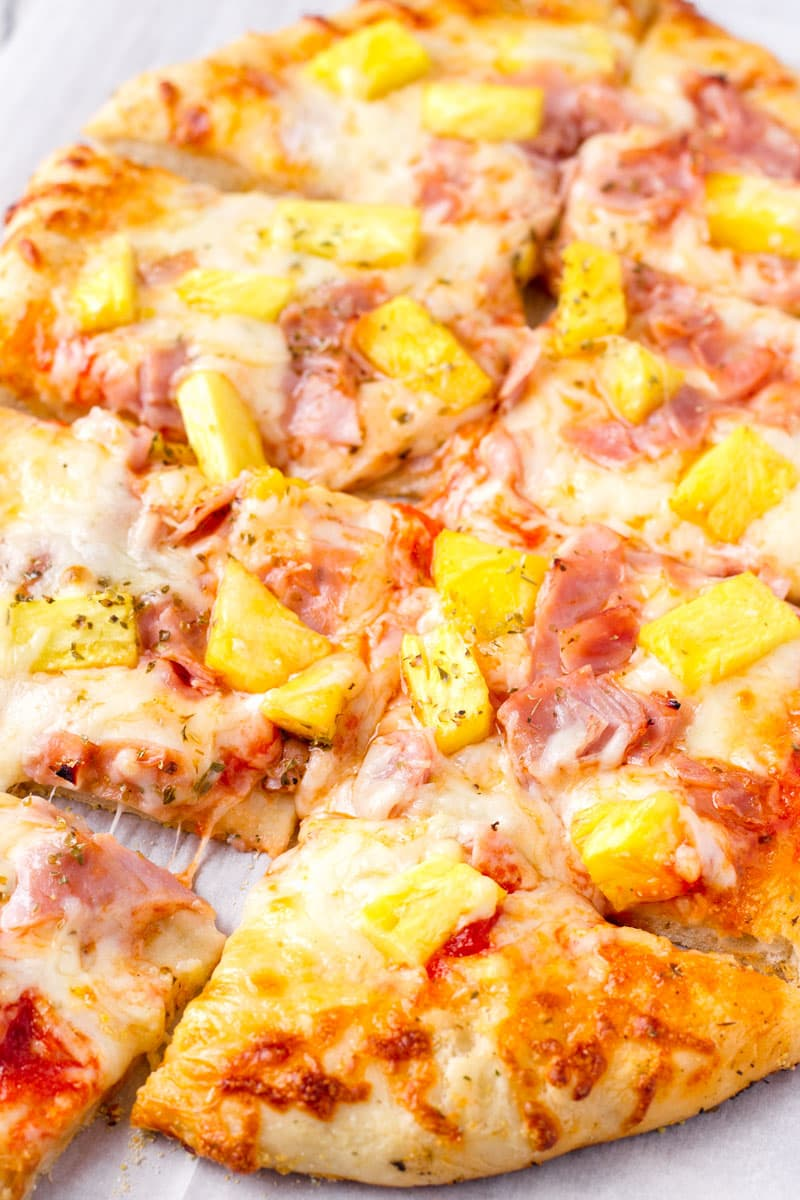 sliced sheet pan pizza with pinapples and ham