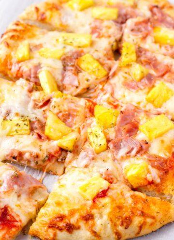 homemade cheesy hawaiian pizza sliced