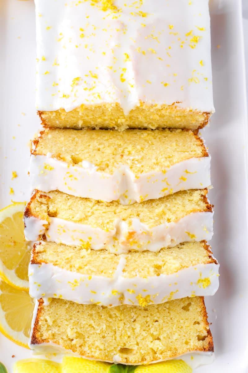 lemon loaf cake with icing and lemon zest on top