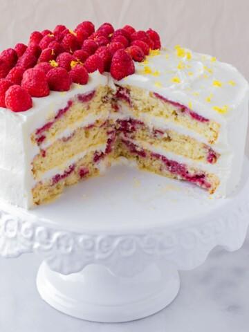 inside of a three layer lemon raspberry cake with fresh raspberries