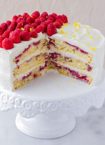inside of a three layer lemon raspberry cake with fresh raspberries