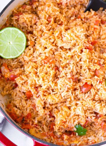 top view of easy tomato mexican rice with lime garnish