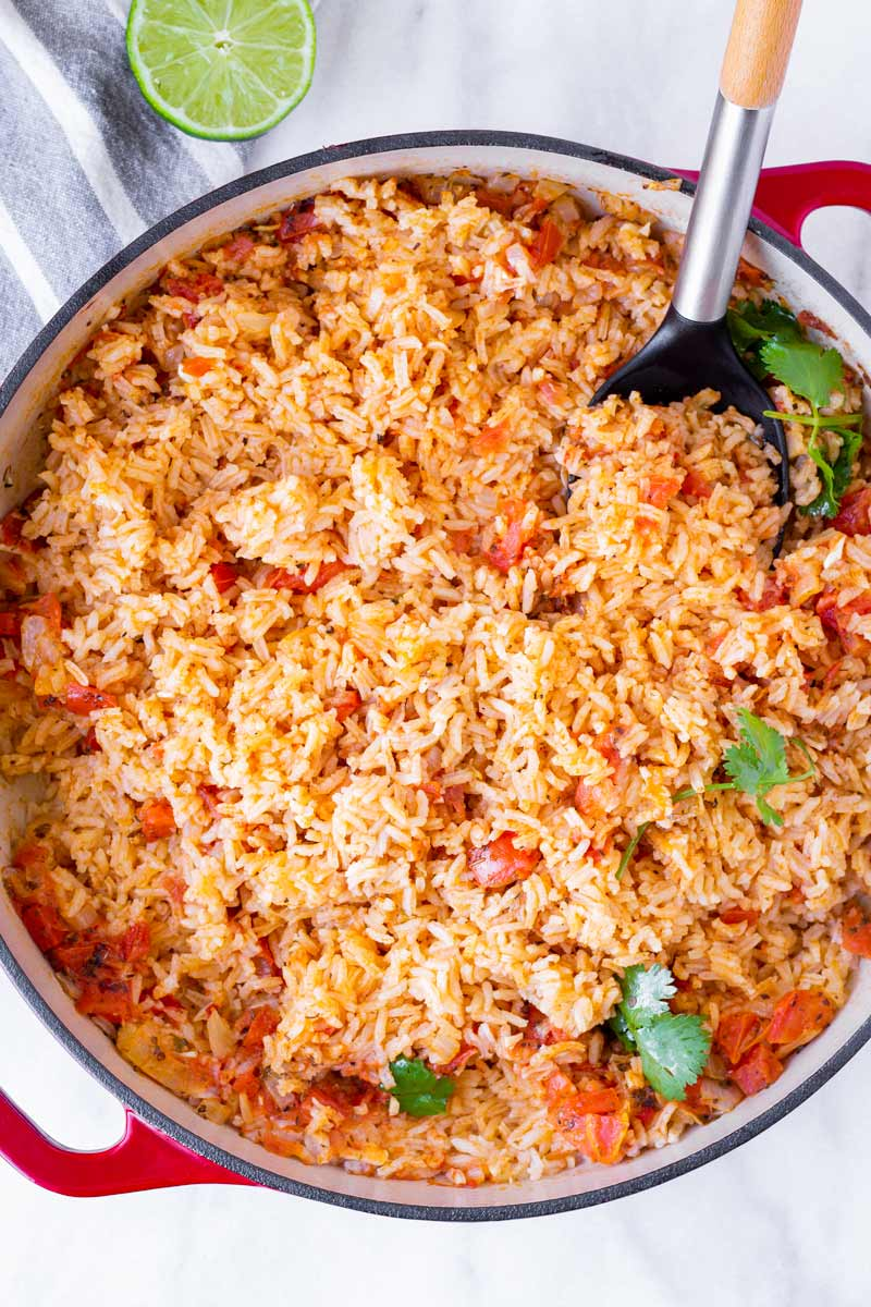 top view of cooked restaurant style spanish rice in a red Dutch oven pot