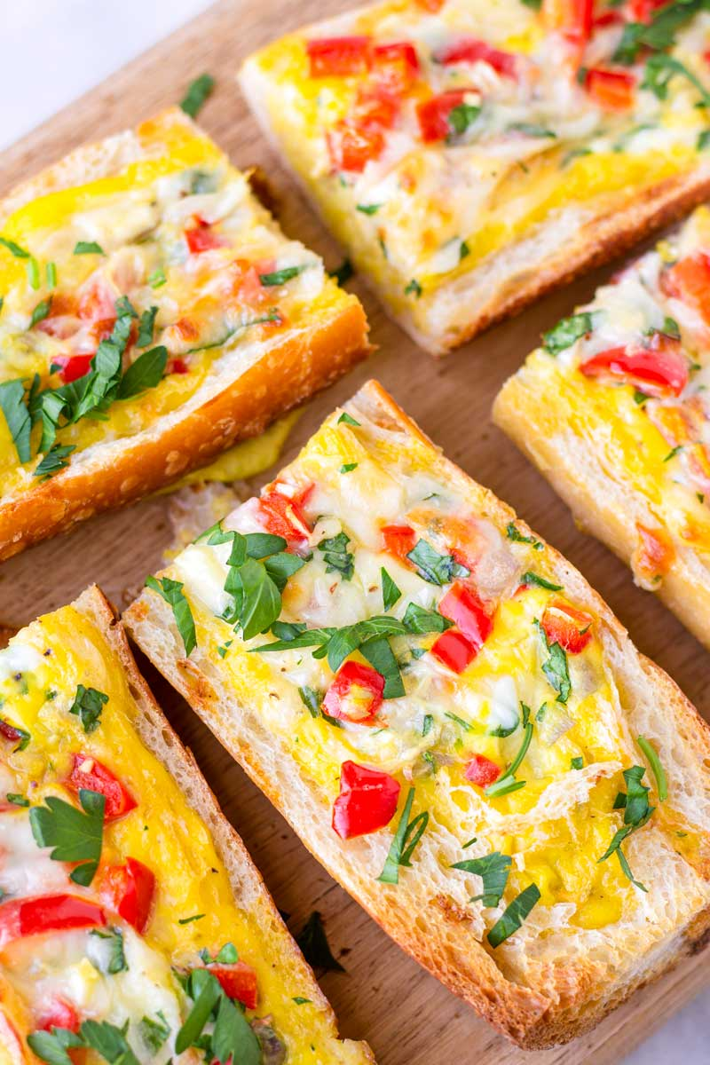 close up of baked bread filled with egg and veggie mix