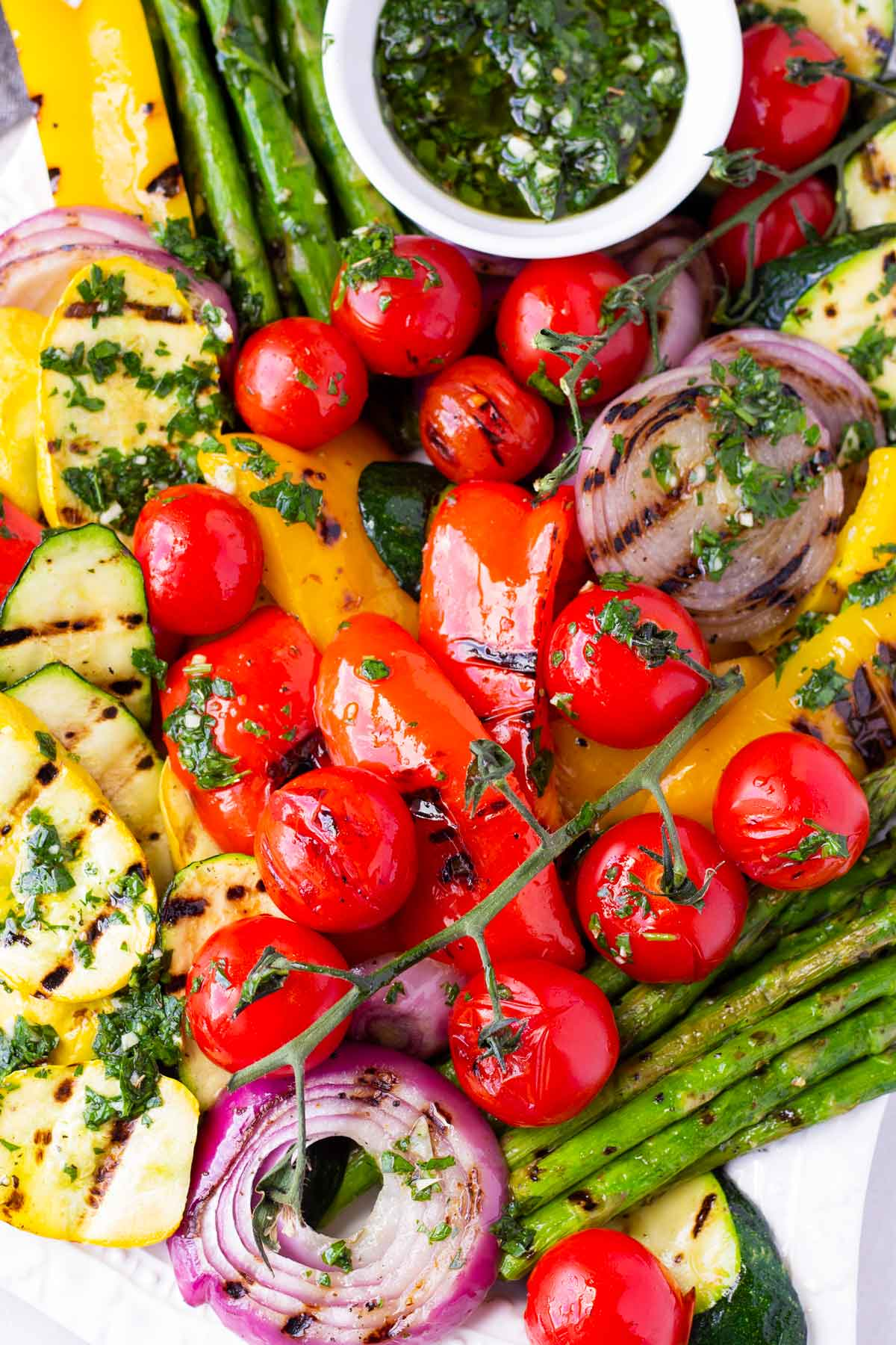 grilled tomatoes on the vine, asparagus, red onions, and zucchini with herb sauce