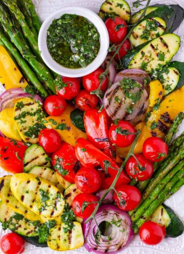 summer grilled vegetable platter with herb sauce on the side