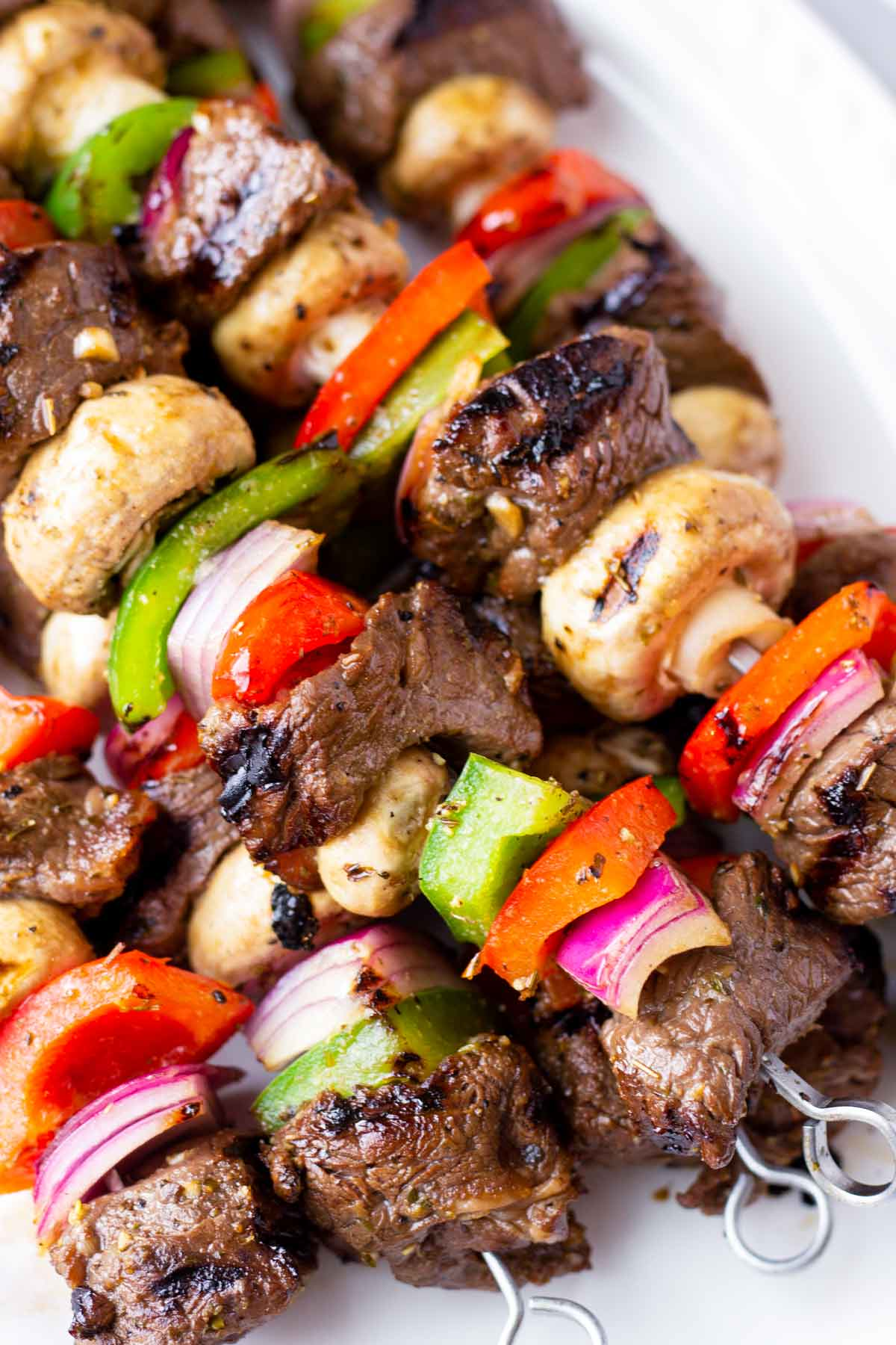 close up of grilled marinated steak kabobs