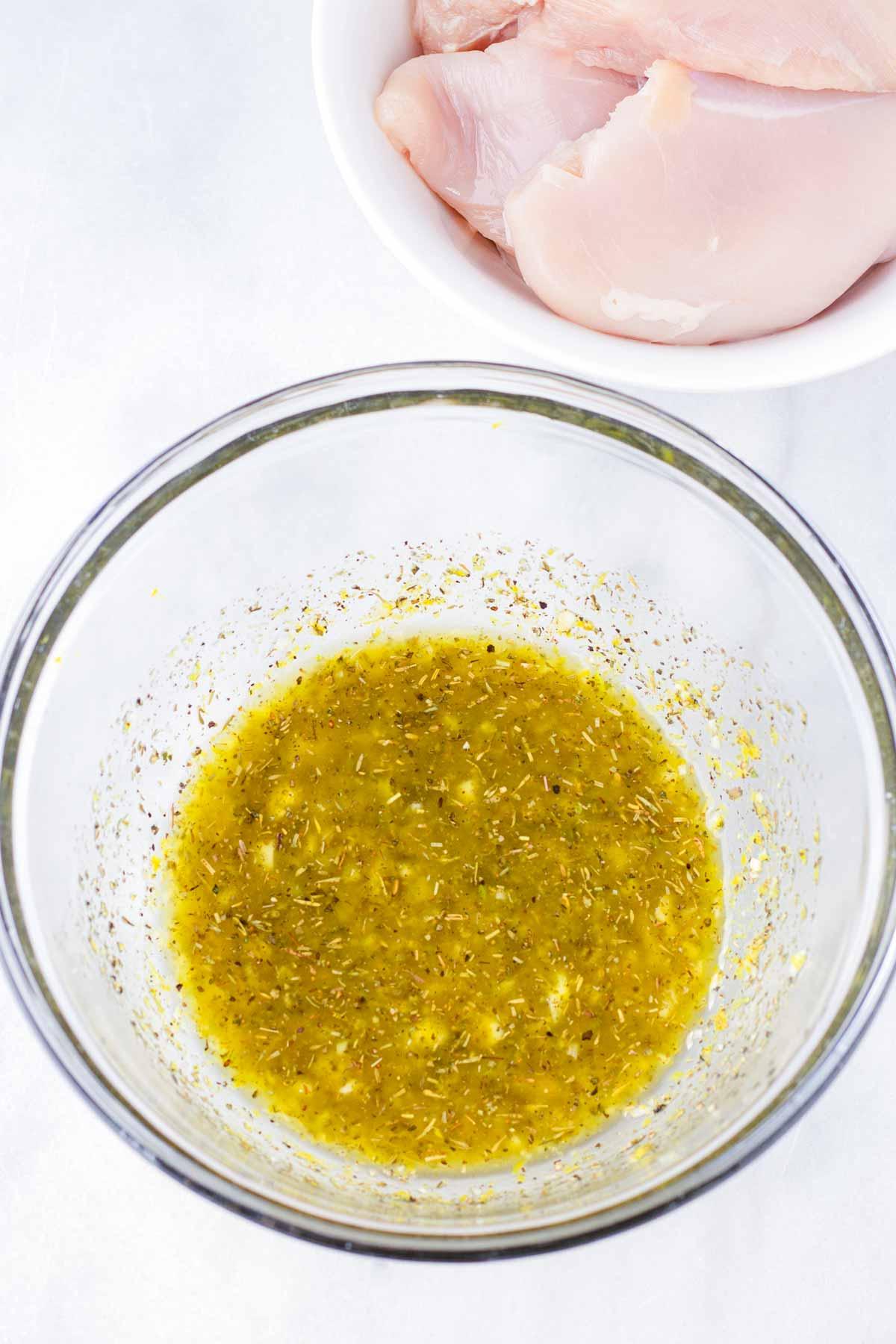mixed lemon, garlic, and herb marinade in a glass bowl