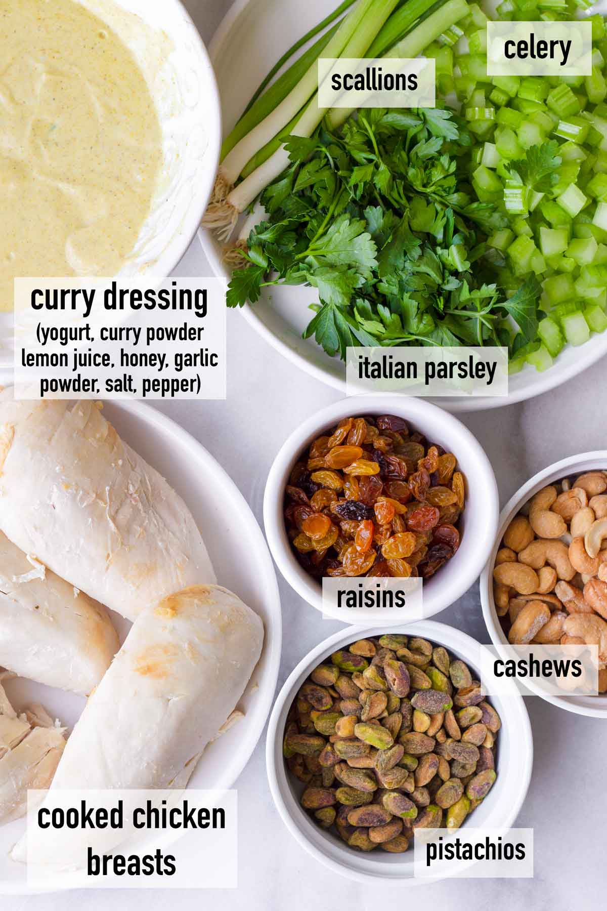 ingredients to make curried chicken salad in small bowls