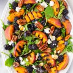 peach salad with fresh fruits and greens