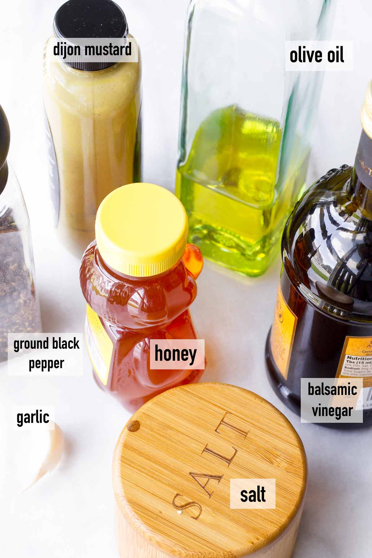 ingredients including mustard, olive oil, balsamic, honey, salt, garlic, pepper