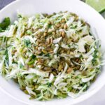 bright mexican slaw salad with pepitas, cumin, and lime dressing