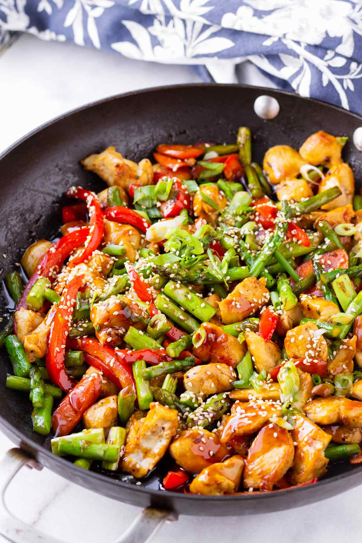 Asian sauted chicken with mixed vegetables in skillet