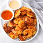golden brown coconut shrimp with two sweet chili sauces