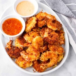 deep fried coconut shrimp platter with two sauces