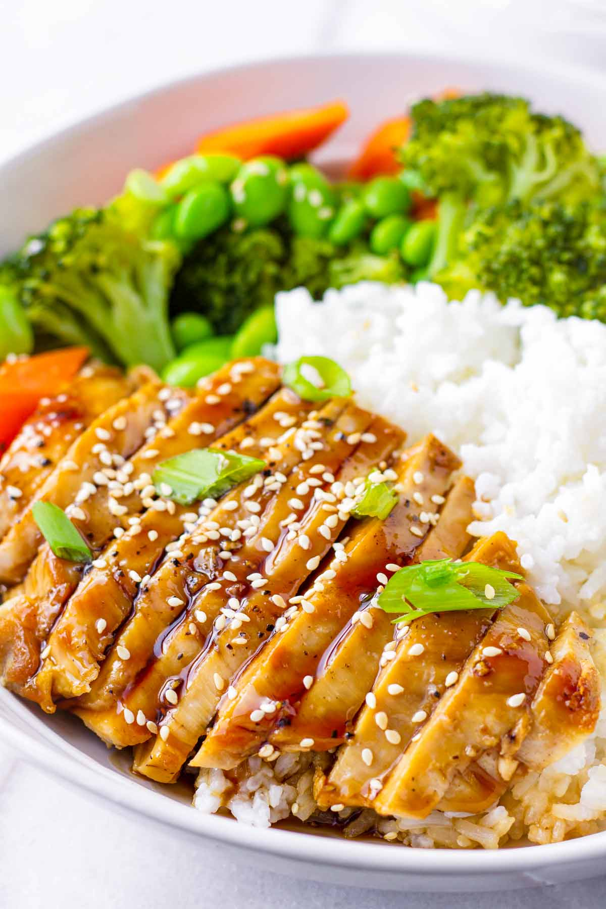 close up view of sliced chicken with glaze