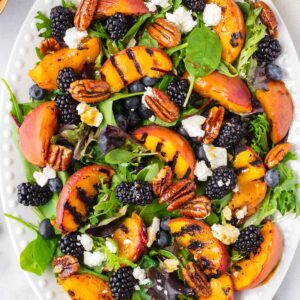 grilled peach salad with berries and greens