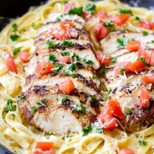 cajun chicken pasta with tomato topping