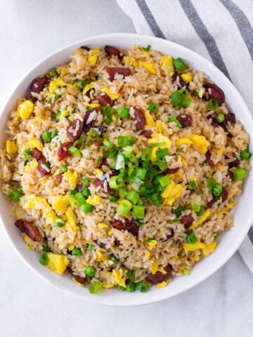 chinese sausage fried rice in bowl with napkin