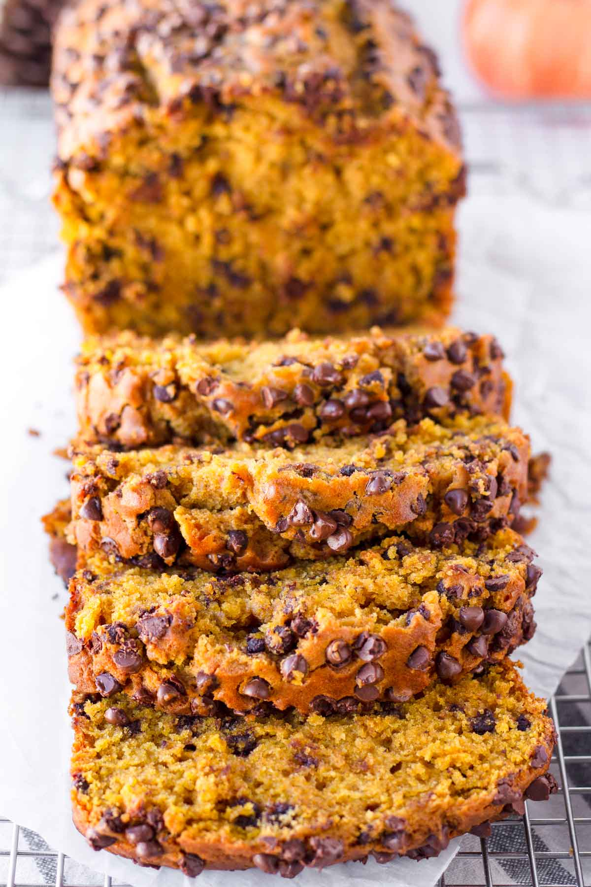 sliced pumpkin chocolate bread on a cooling rack