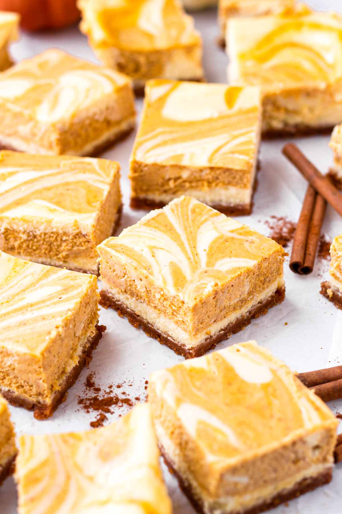 side view of cream cheese squares with pumpkin swirl