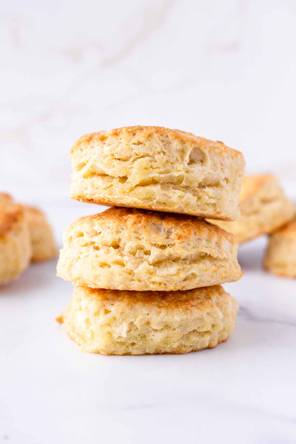 three flaky southern biscuits stacked on top of each other