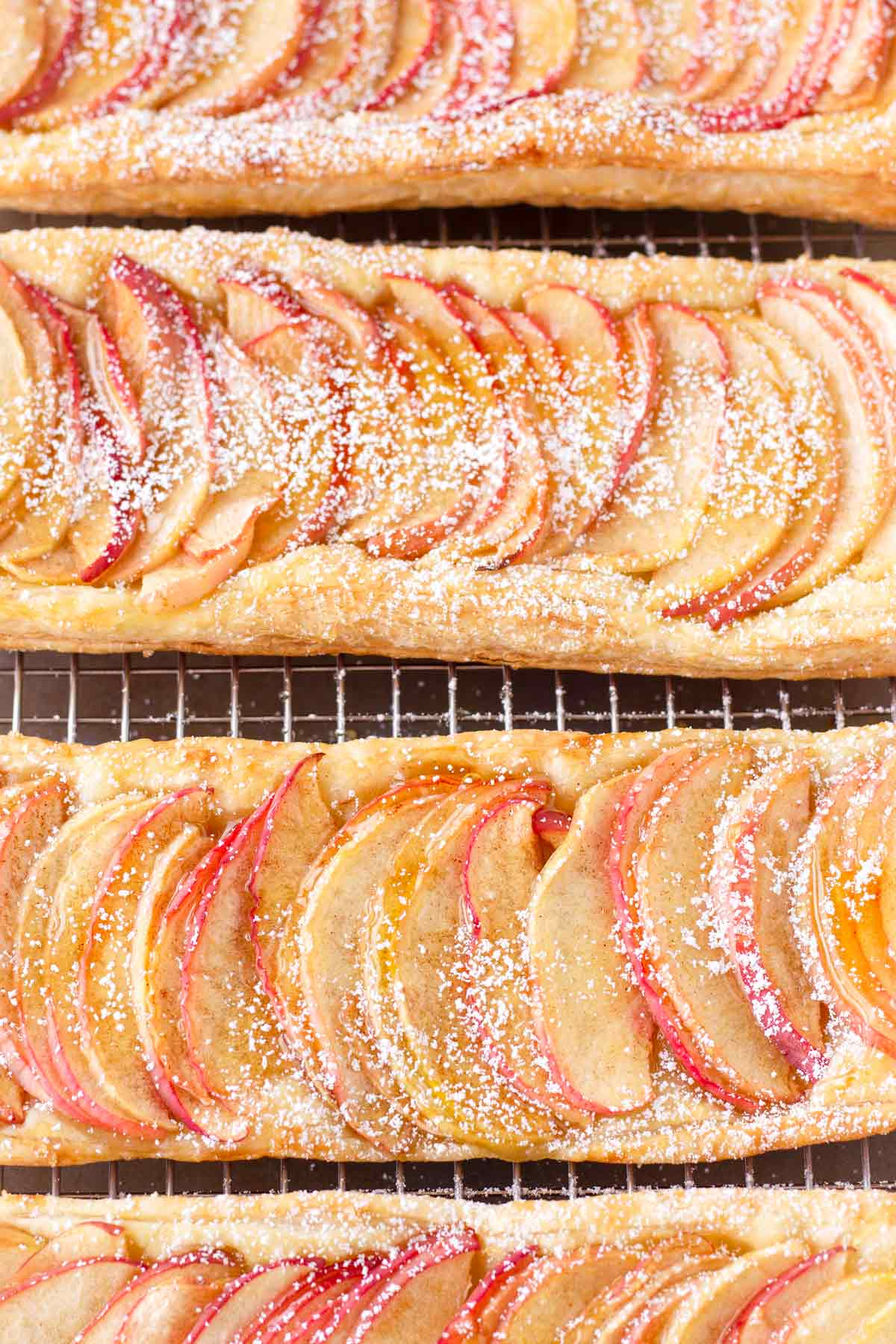 top view of baked honeycrisp apple tarts on flaky pastry