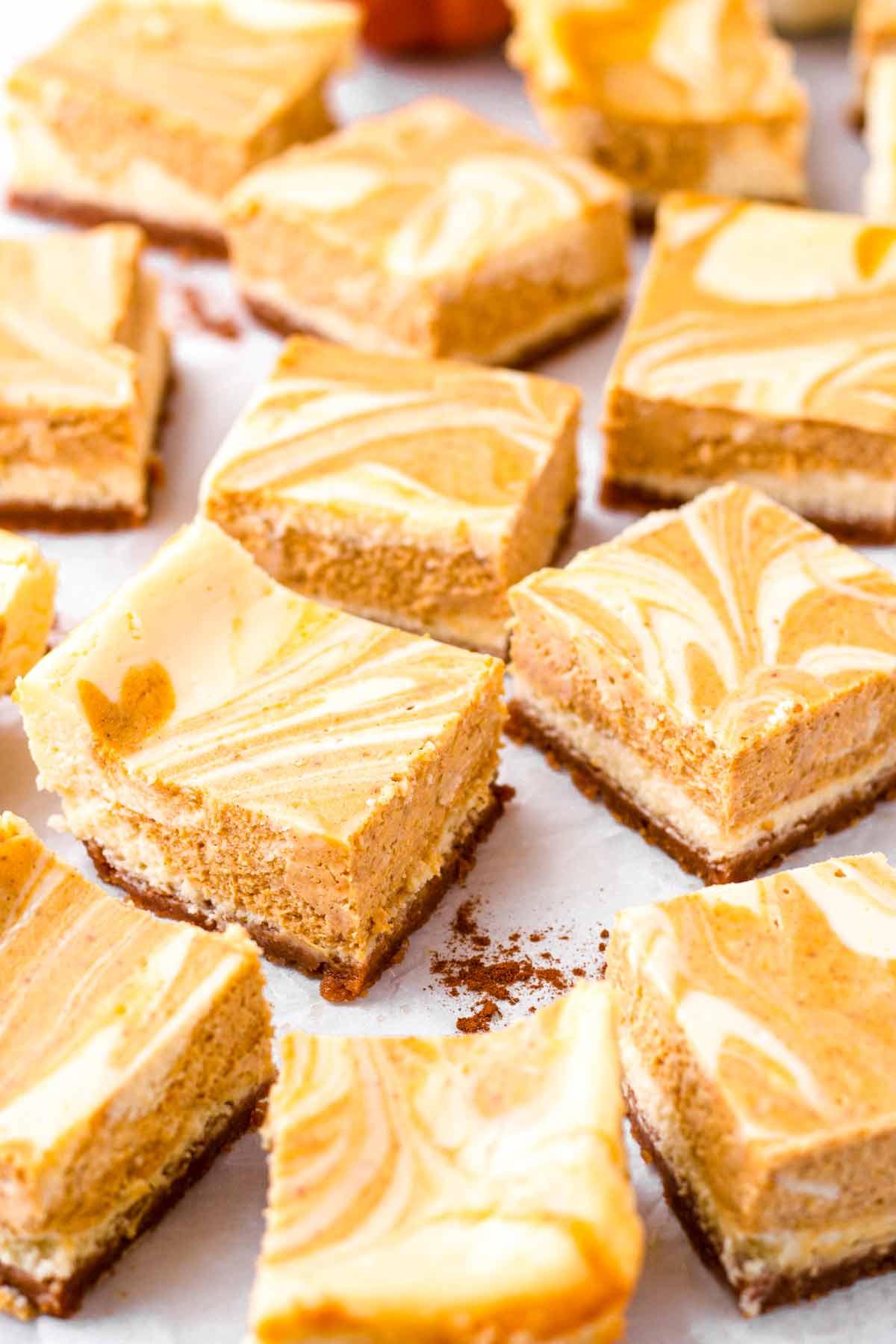 pumpkin spice cheesecake bars cut into squares