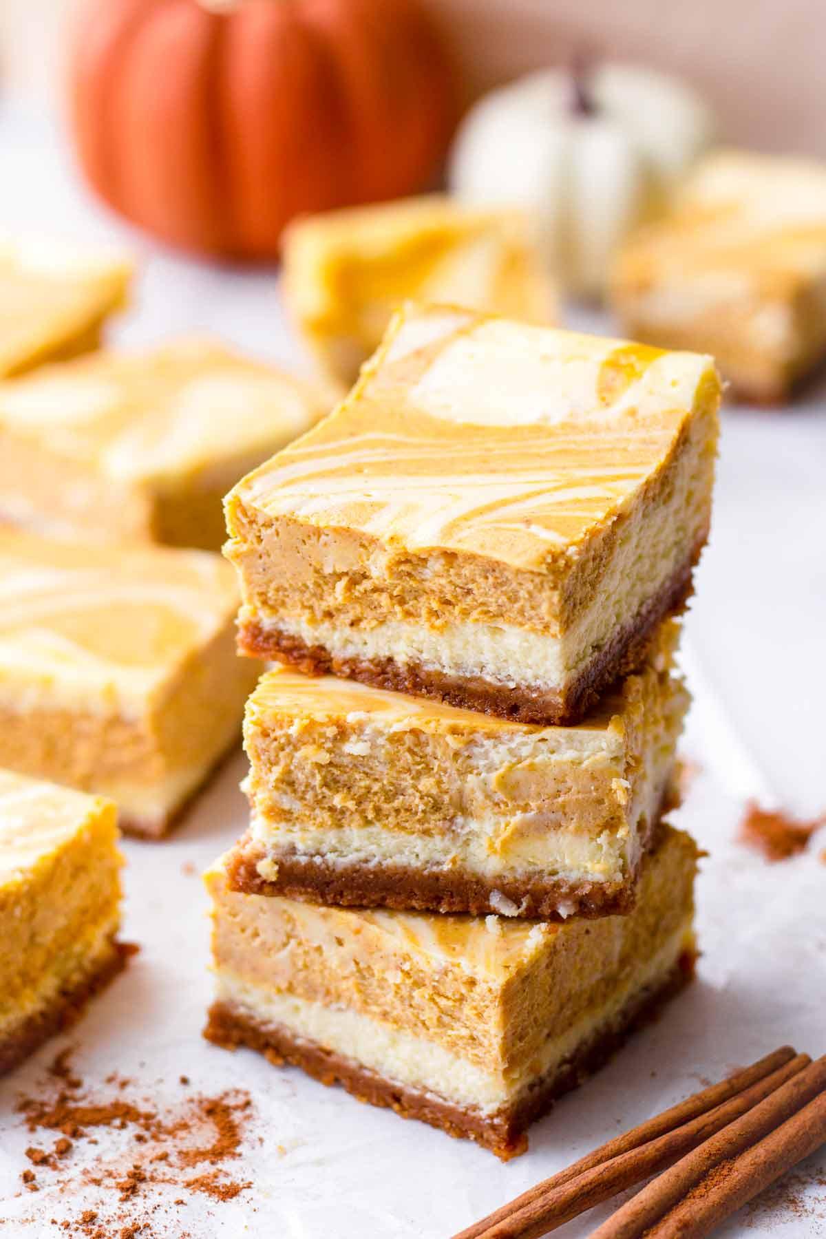 three pumpkin cheesecake bars stacked on top