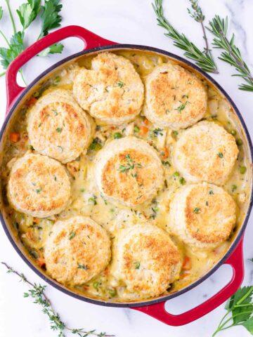 baked buttermilk biscuit chicken pot pie in red dutch oven