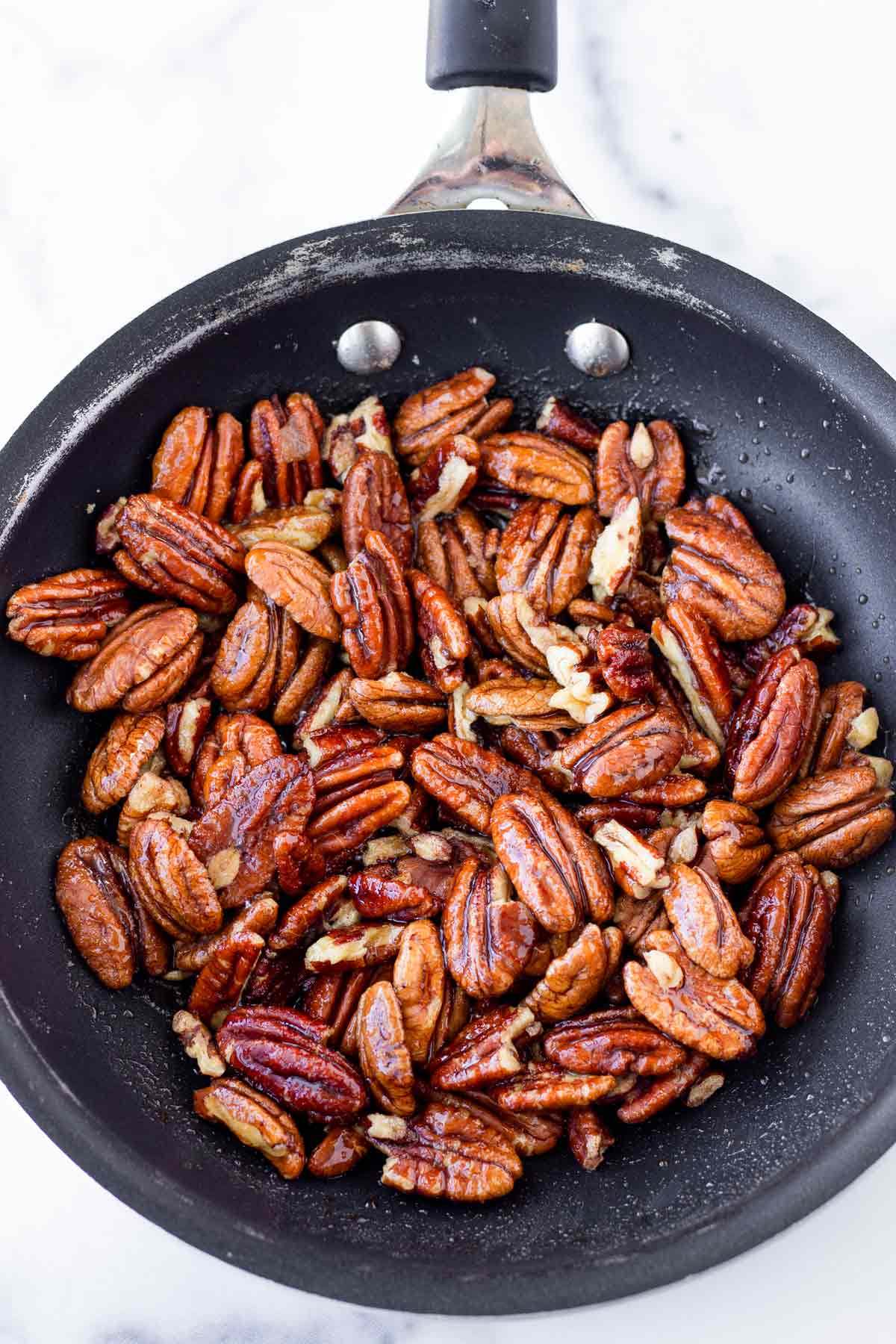 candied pecans in a small non-stick skillet