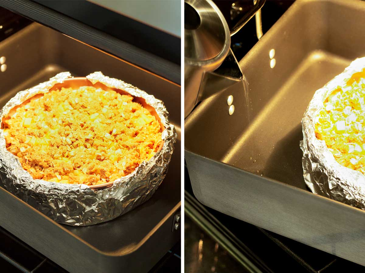 unbaked cheesecake in a roasting pan with water being poured onto for water bath